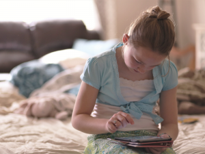 Tween girl on tablet